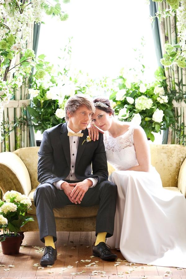 Bride resting on groom's shoulder