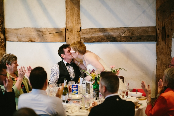 Bride kissing groom after speech