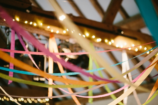 Coloured streamers across beamed ceiling