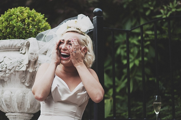Bride with hands on face