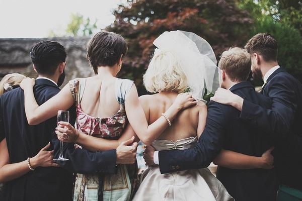 Bridal party hug