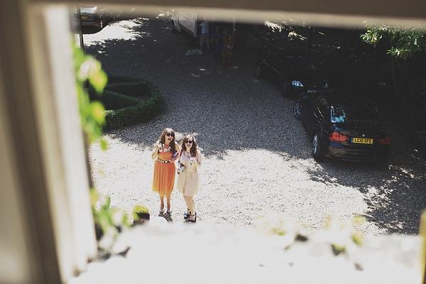 2 girls seen from window