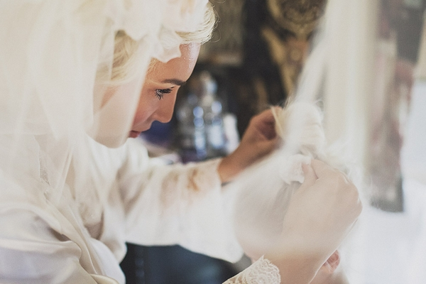 Bride putting flower in young girl's hair