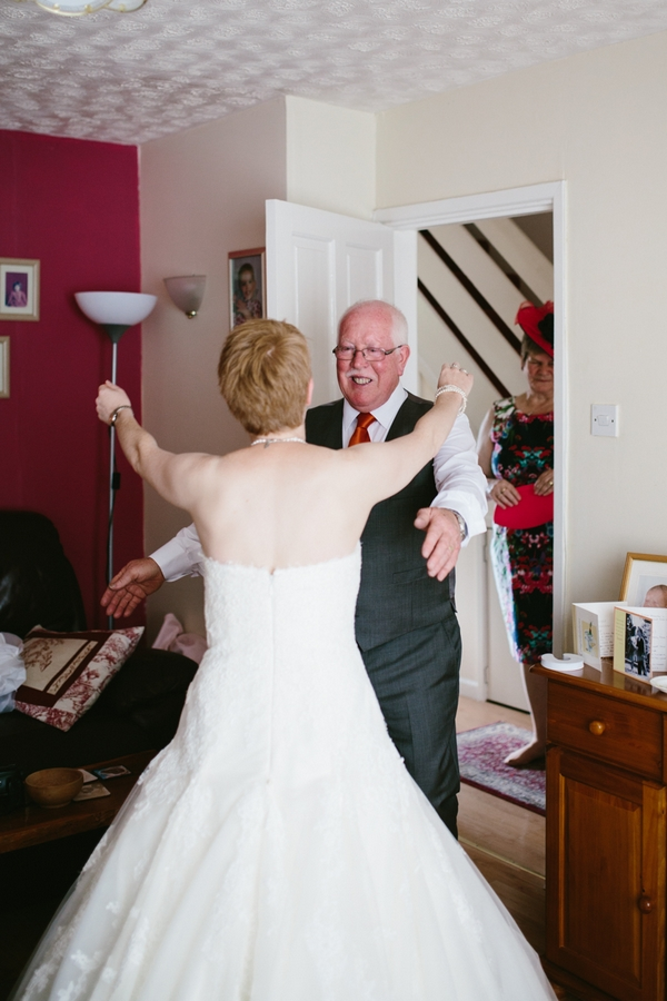 Bride and father about to hug