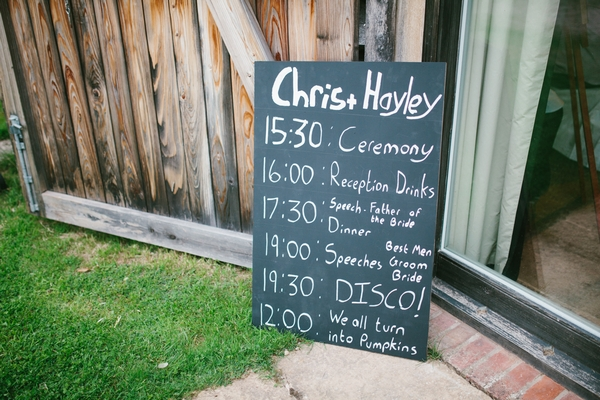 Wedding order of service written on chalkboard