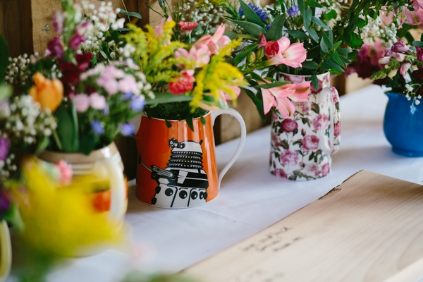 Jugs of wedding flowers