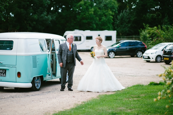 Bride arriving at wedding in VW Camper Van