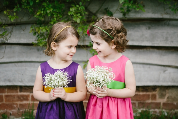 Flower girls in pink and purple dresses