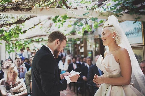 Groom reading in wedding ceremony