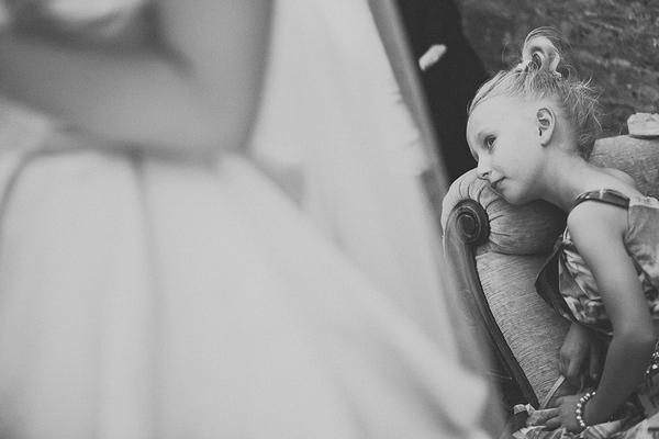 Young girl laying on chair in wedding ceremony