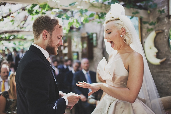 Bride looking excitedly at wedding ring