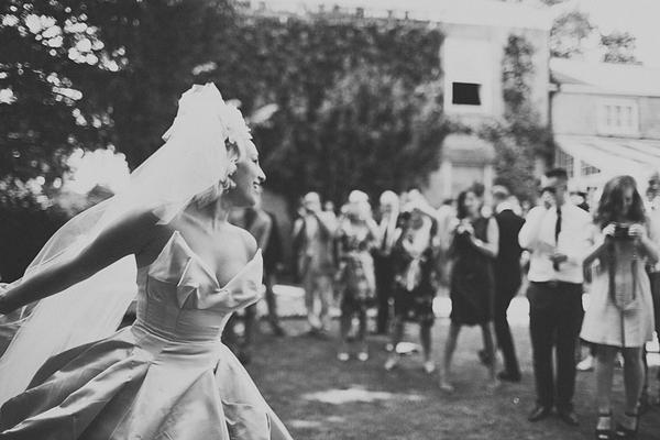 Wedding guests looking at bride