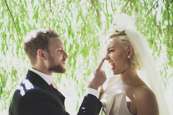 Groom touching bride's nose