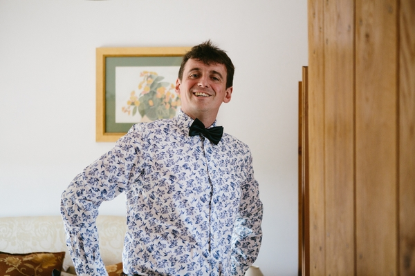 Groom in floral shirt