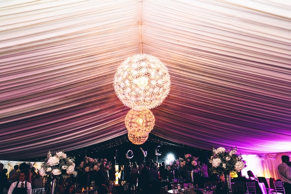 Hanging light decoration in wedding marquee