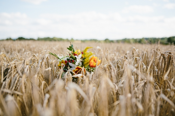 Wedding bouquet in corn field