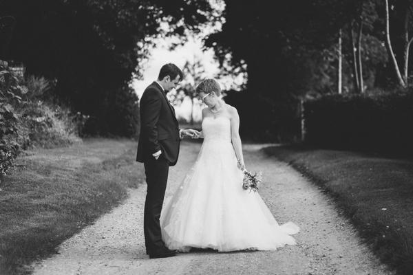 Bride looking at groom's wedding ring