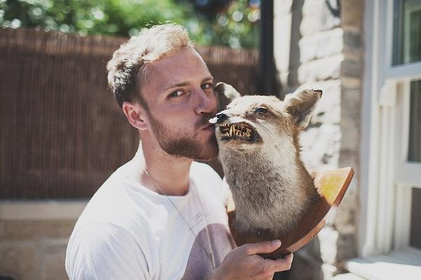 Man kissing taxidermy