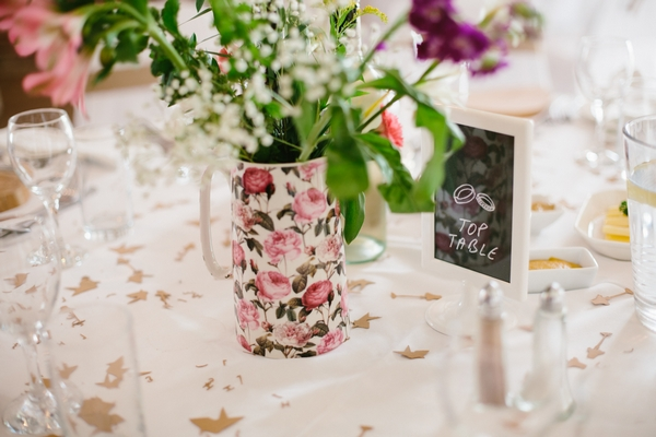 Floral jug on wedding table