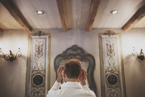 Groom doing hair in mirror