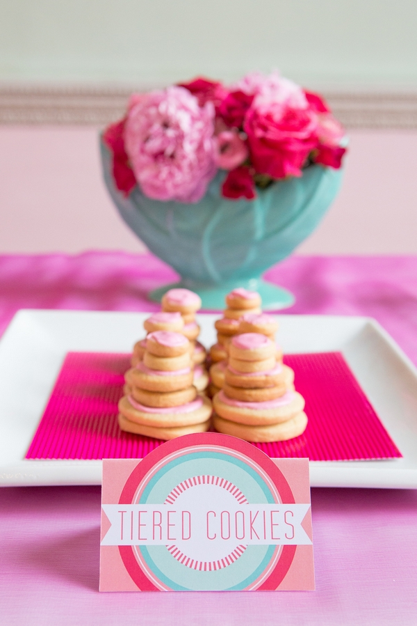 Tiered cookies on square plate with label