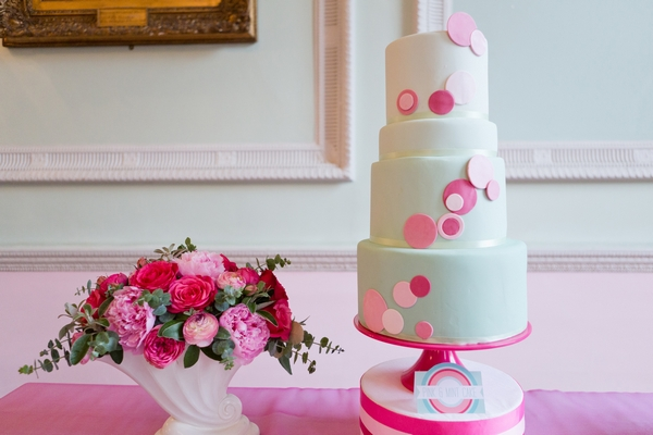 Mint coloured wedding cake with spots, and flowers