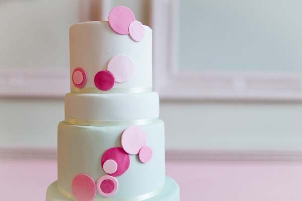 Top of mint coloured wedding cake with spots