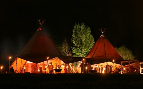Giant hat tipi at night from Magical Events Ltd
