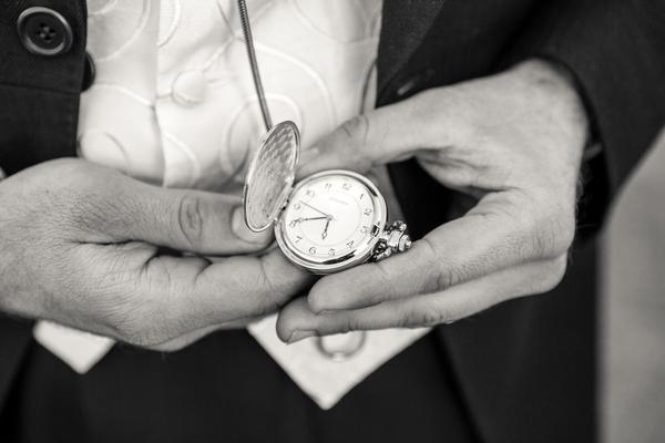 Groom looking at pocket watch