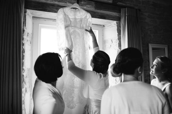 Bride taking wedding dress