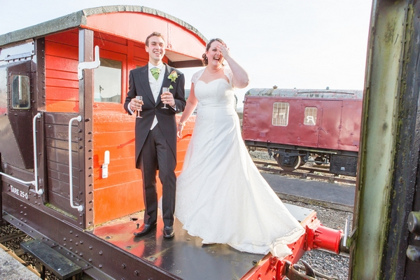 Bride and groom on train carriage