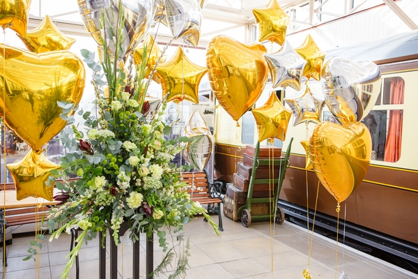 Gold heart and star balloons