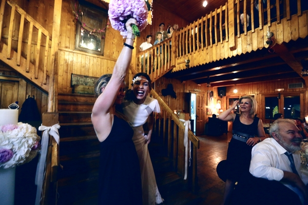 Bride with woman who caught bouquet