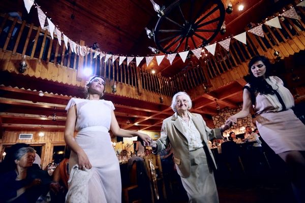 Bride holding hands with elderly lady