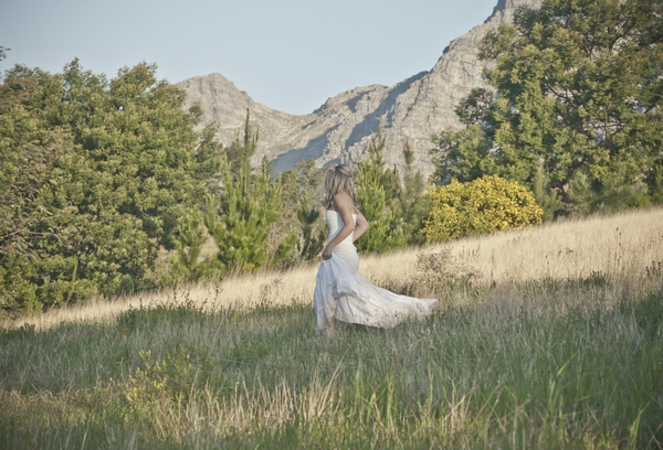 Bride walking across field