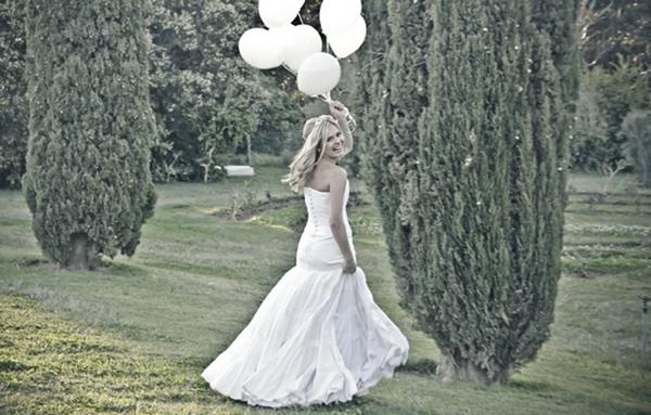 Bride holding balloons