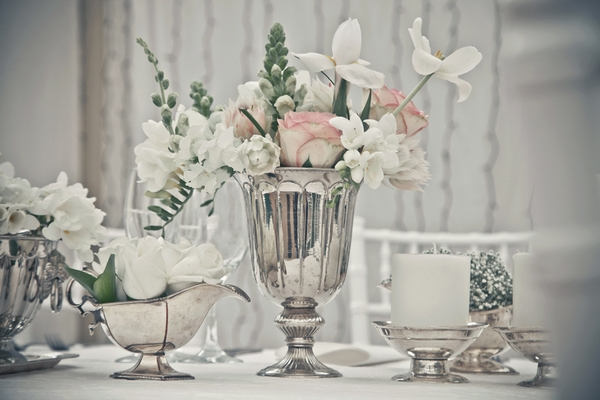 Silver vase of wedding table flowers
