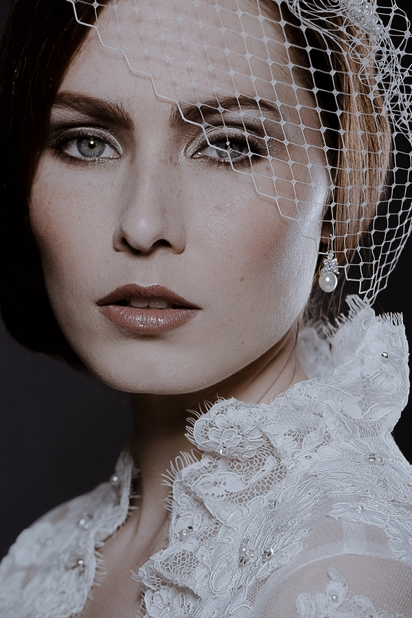 Model wearing Short Birdcage Veil by Debbie Carlisle