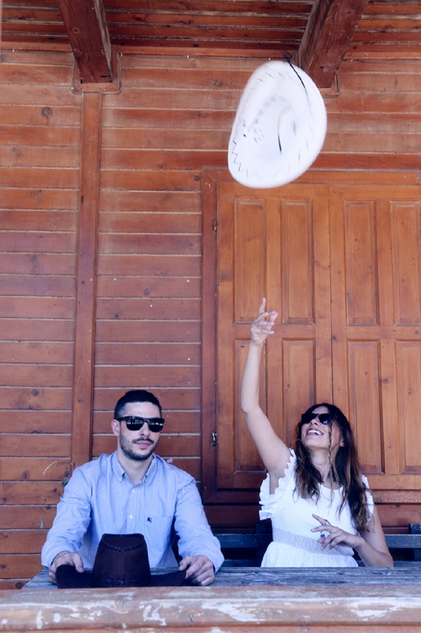 Woman throwing cowboy hat in the air