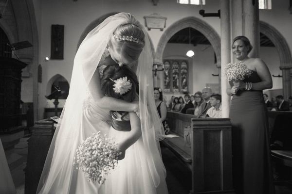 Bride hugging girl - Picture by Linus Moran Photography