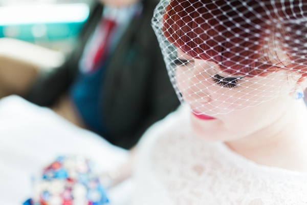 Bride wearing birdcage veil - Picture by Jay Emme Photography