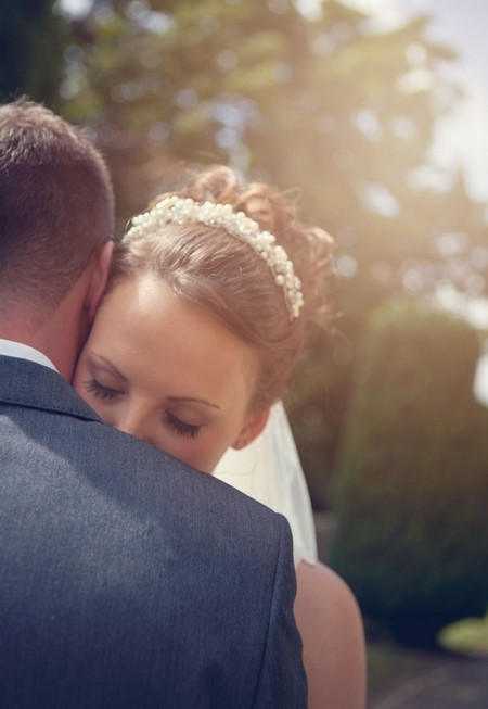 Bride and groom hugging - Picture by Jade Nott Photography