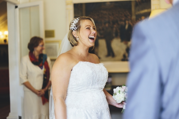 Bride laughing in wedding ceremony