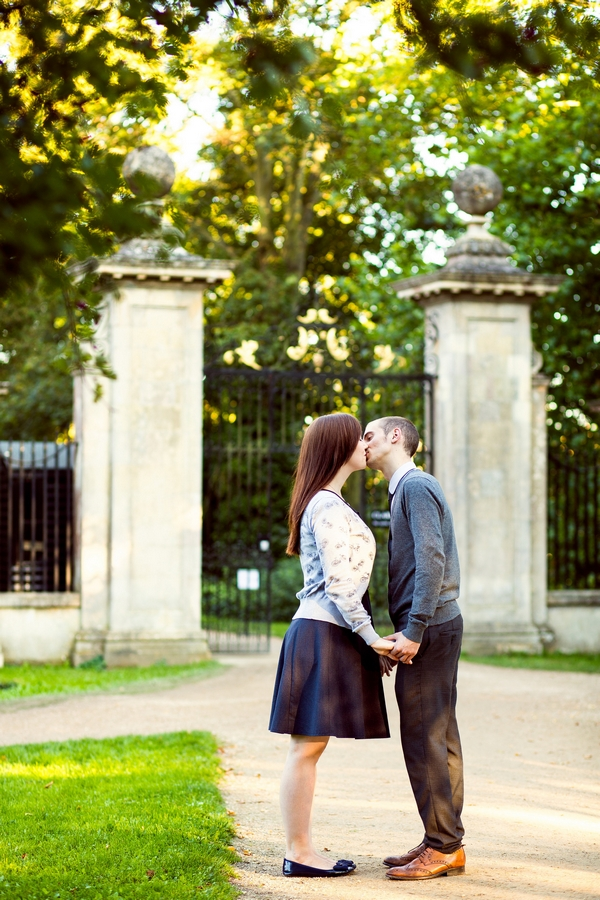 Couple kissing in front of gate