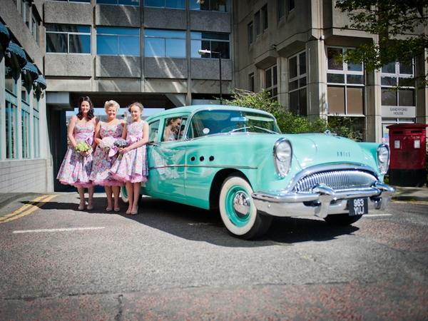 Bridesmaids next to wedding car