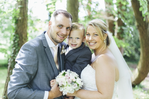 Bride and groom with son