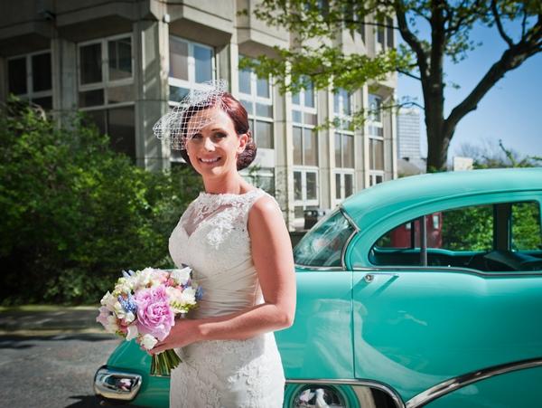 Bride next to wedding car