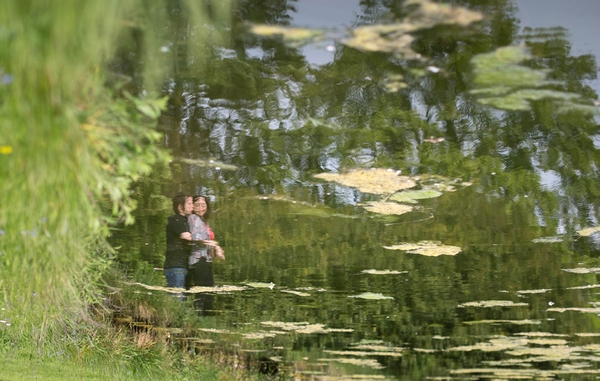 Reflection of engaged couple in water