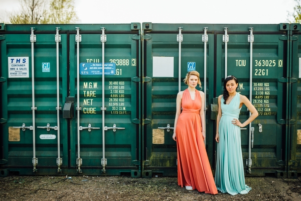 Bridesmaids in coral and blue dresses
