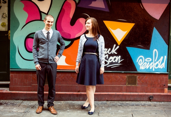 Couple in front of graffiti wall